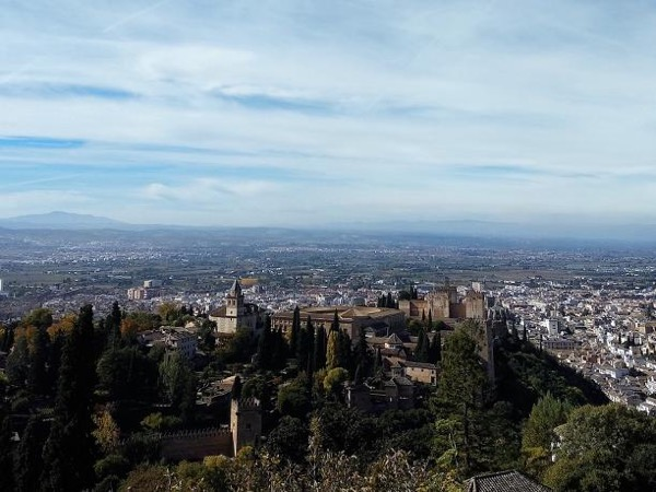 Urban hiking in Granada with panoramic views in Realejo, Alhambra forest and sunset on the hill of the sun
