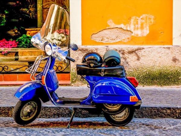 Vespa Tour: Amalfi Coast and Sorrento riding a Vespa scooter